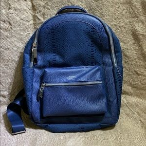 Brand new Vince Camuto blue messenger backpack
